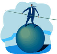 animated image of man standing atop big, rolling ball while holding a long stick with both hands to balance managing inventory