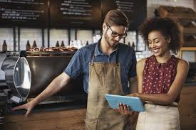 smiling couple with tablet showing painless multichannel integration success