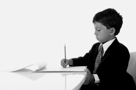 little boy at desk writing product listings