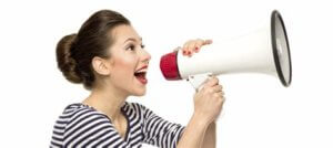 woman shouting through bullhorn to drive ecommerce sales