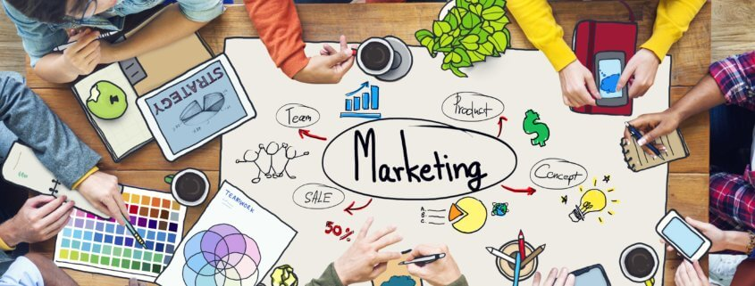 group of people charting low cost marketing tactics