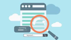 magnifying glass highlighting SEO keywords to sell