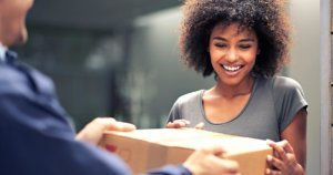 offering customers free shipping smiling woman accepting package