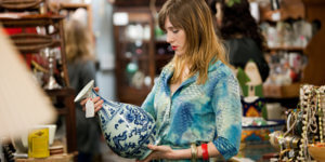 woman at thrift store to source sellable products