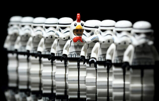 line of black and white robots with one in color how to build a personal brand
