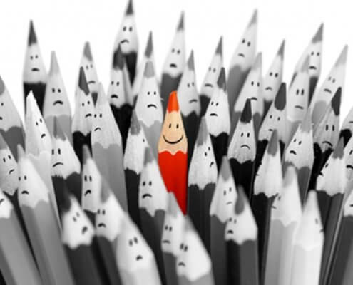 black and white pencils with red one in middle to show how to build a personal brand