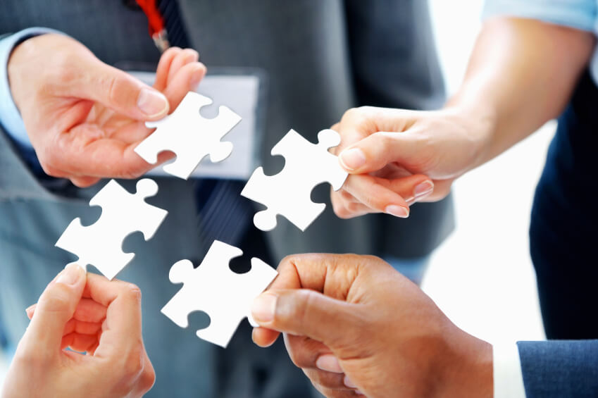 4 people holding puzzle pieces needed to influence online sales