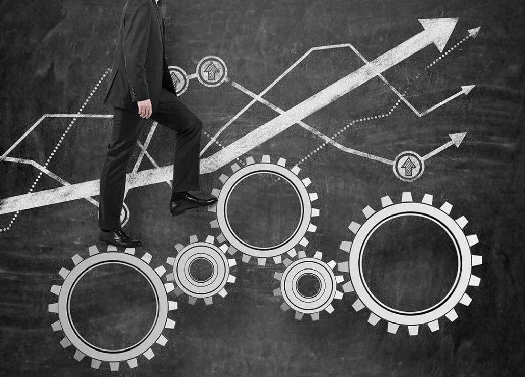 chalkboard imafe of man walking on cogwheels that represent optimizing product listingss