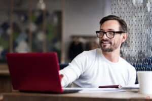 key benefits of using multichannel listing software man sitting at computer smiling