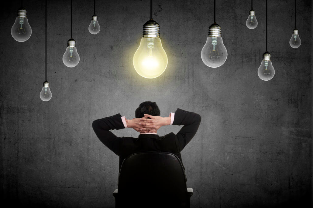 businessman looking at light bulbs symbolizes topics for your e-store blog