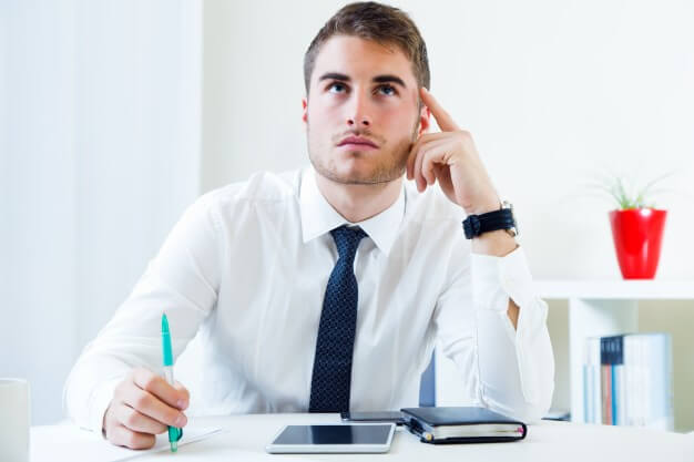 man thinking about an inventory management app for his business