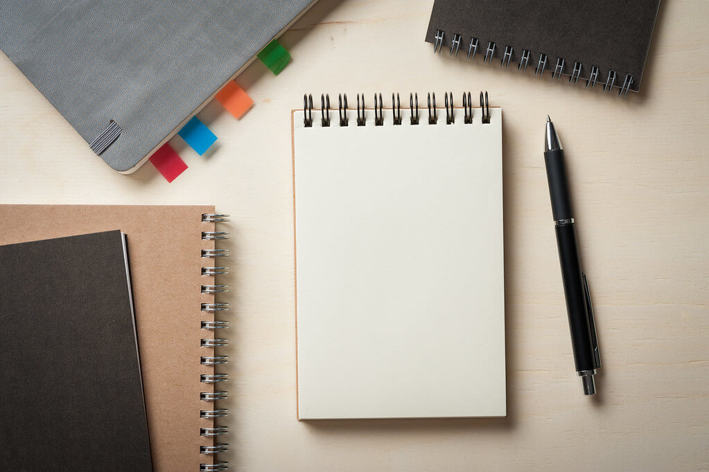 blank notepad on desk symbolizes basics of writing item descriptions